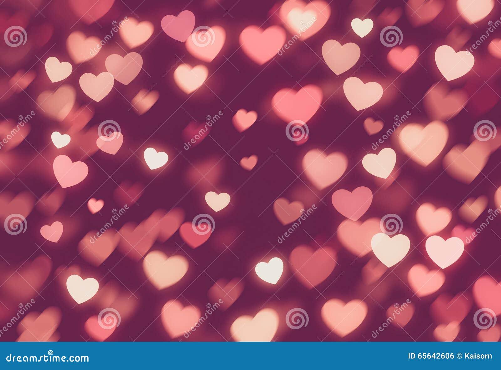 Fond de Saint Valentin de bokeh de coeurs