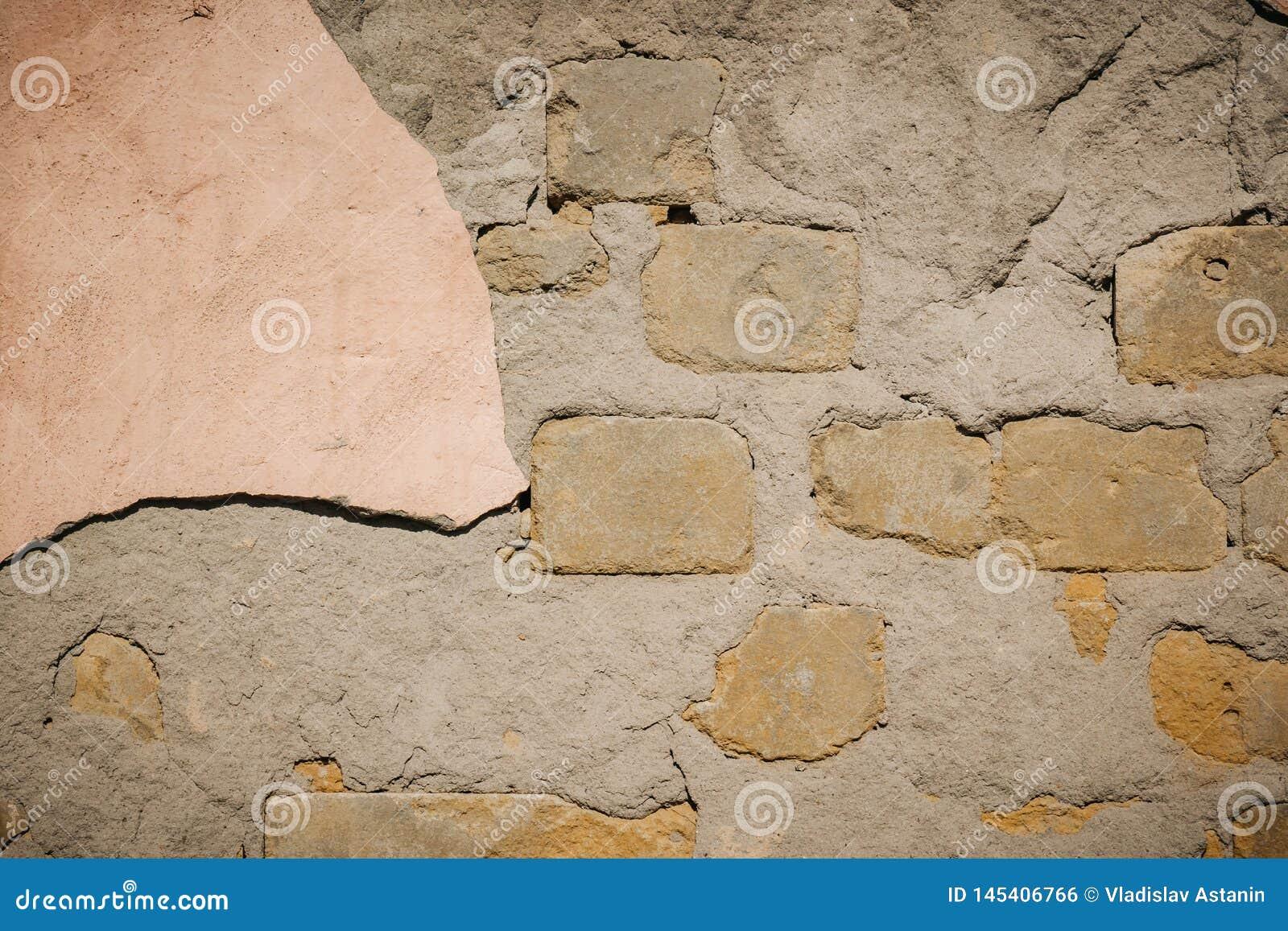 Fond de texture de mur de briques de fente