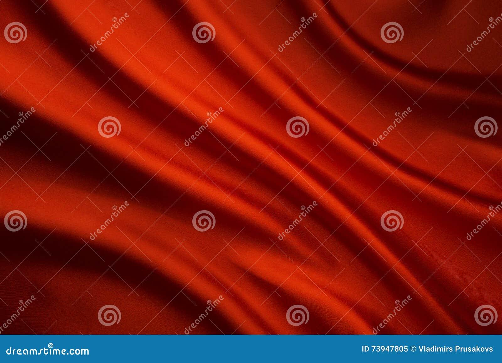 Fond de vague de tissu en soie, texture rouge abstraite de tissu de satin
