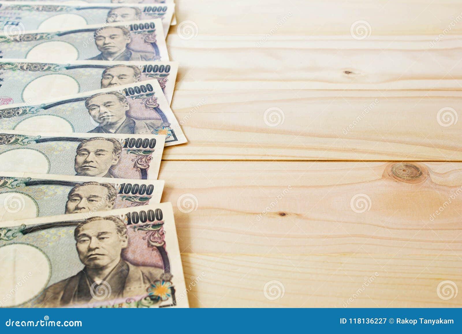 Fond de Yen Banknote On Vintage Wooden d argent