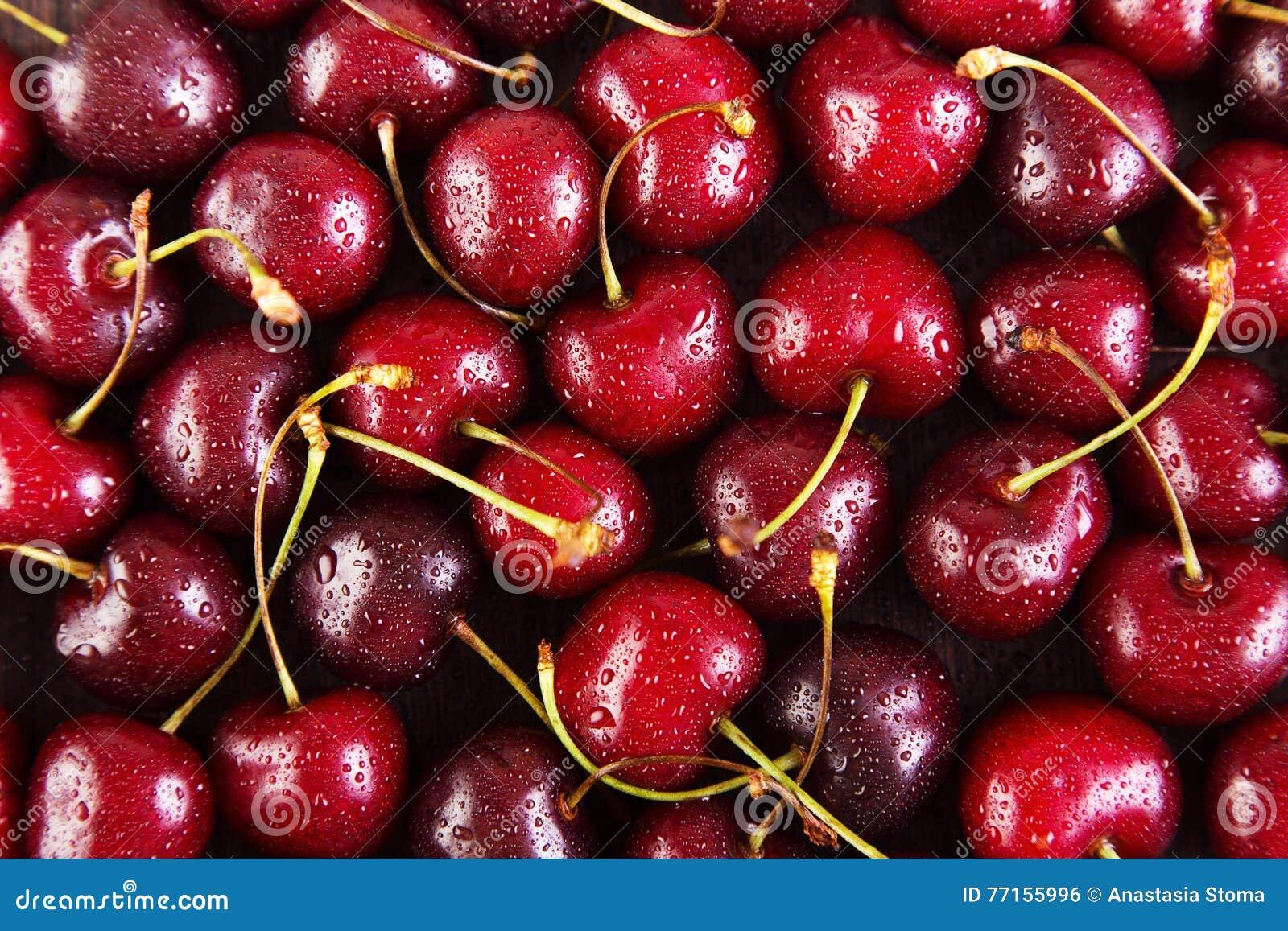 Fond des cerises rouges