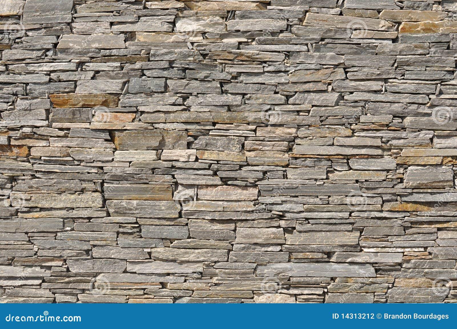 Fond en pierre gris de mur de briques photographie stock Mur de brique gris
