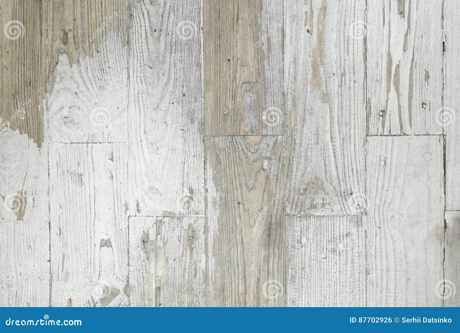 Fond grunge de texture en bois blanche peinte superficielle par les agents de planche