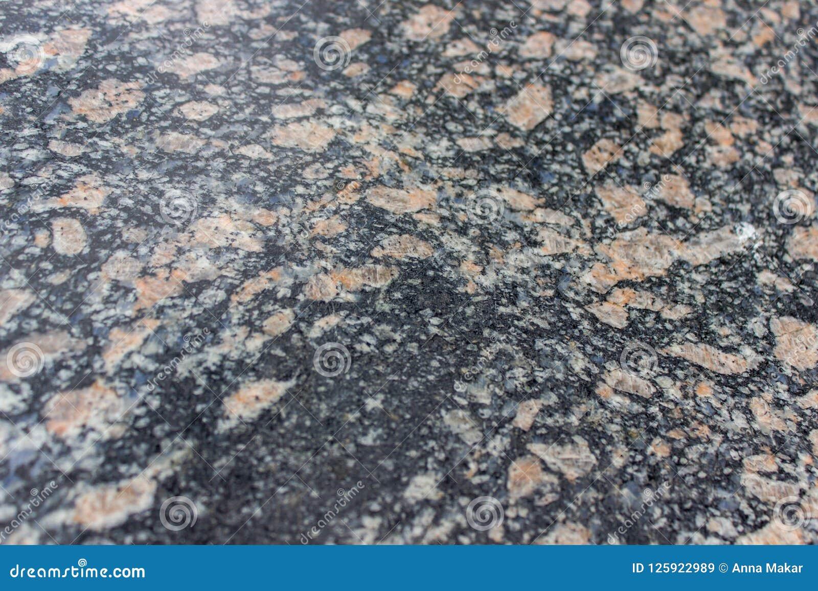 Pierre De Parement En Granit fond noir et brun de granit parement du matériel, texture en