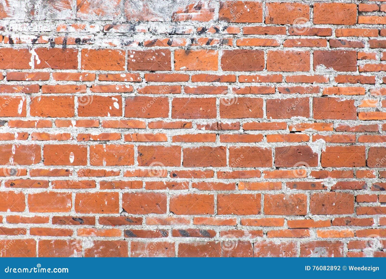 Fond orange grunge de texture de mur de briques