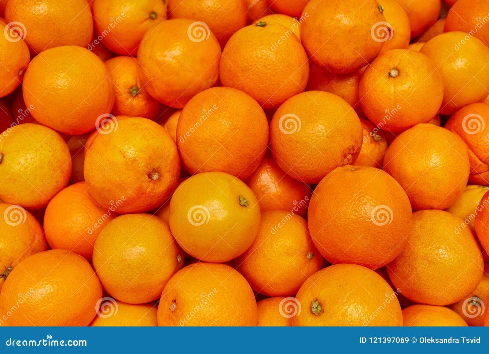Fond orange, produit orange au marché