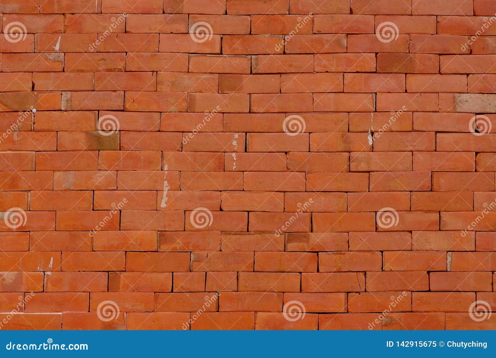 Fond rouge grunge de mur de briques