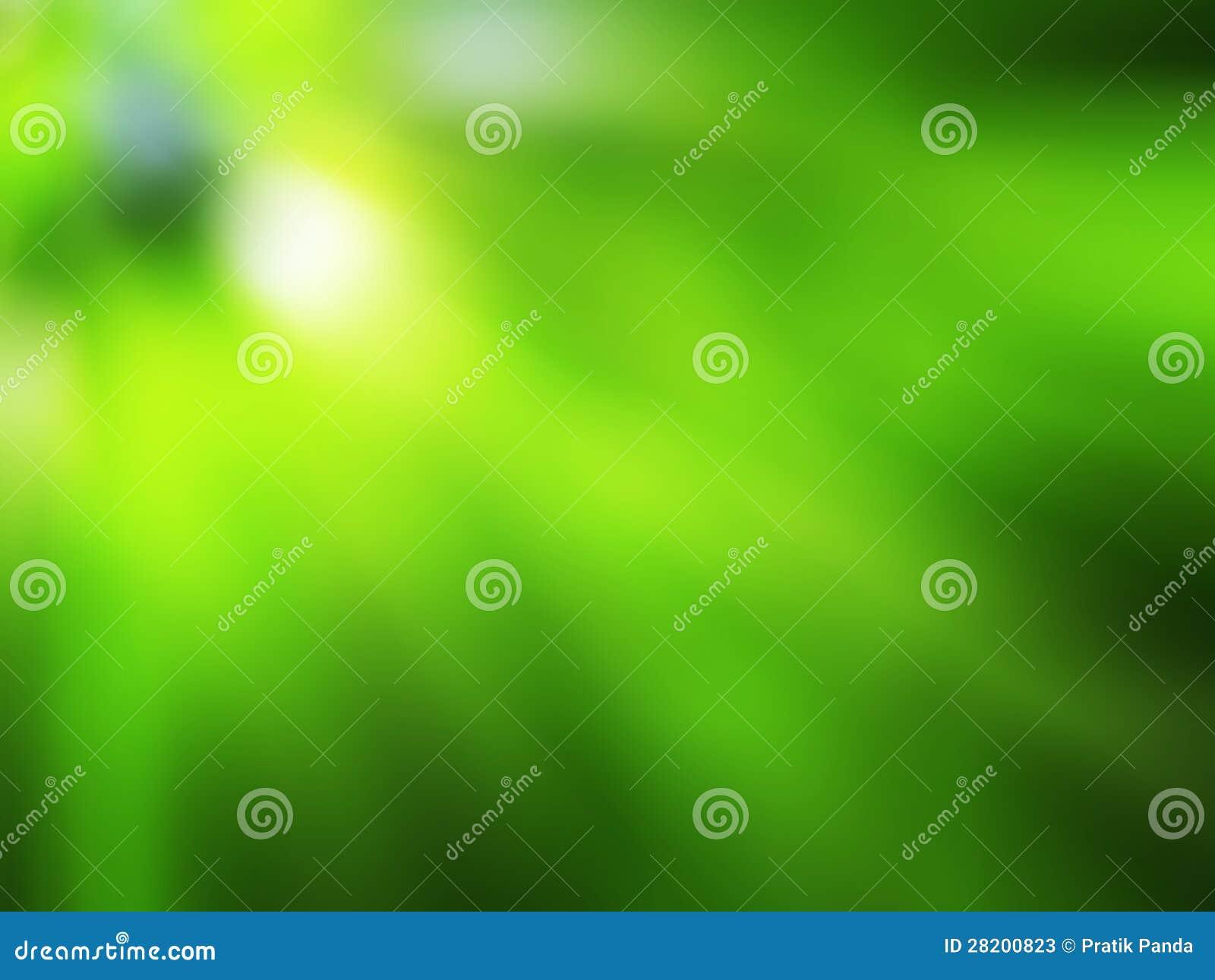 Fond vert avec les rayons brouillés