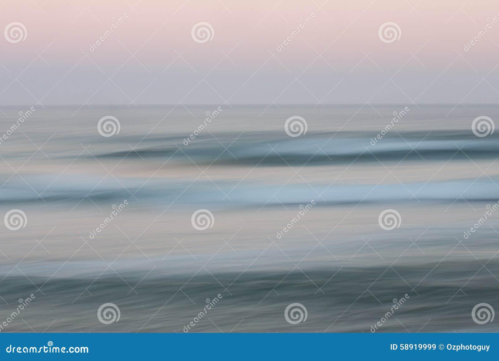 Fondo abstracto del océano de la salida del sol con el movimiento de filtrado borroso