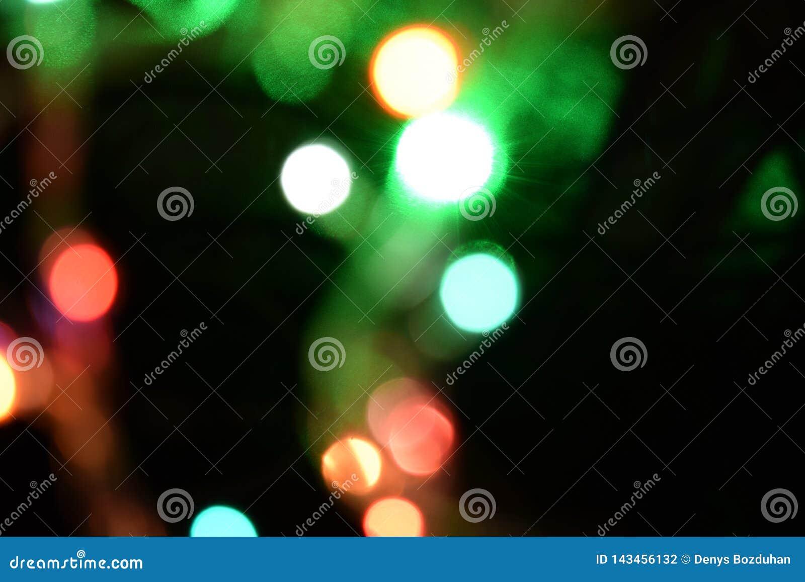 Fondo abstracto ligero de Bokeh Remiendos de Varicoloureds de la luz para el fondo