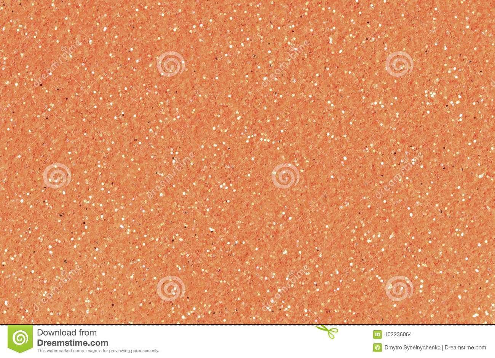Fondo anaranjado de la Navidad de la textura del brillo Foto baja del contraste