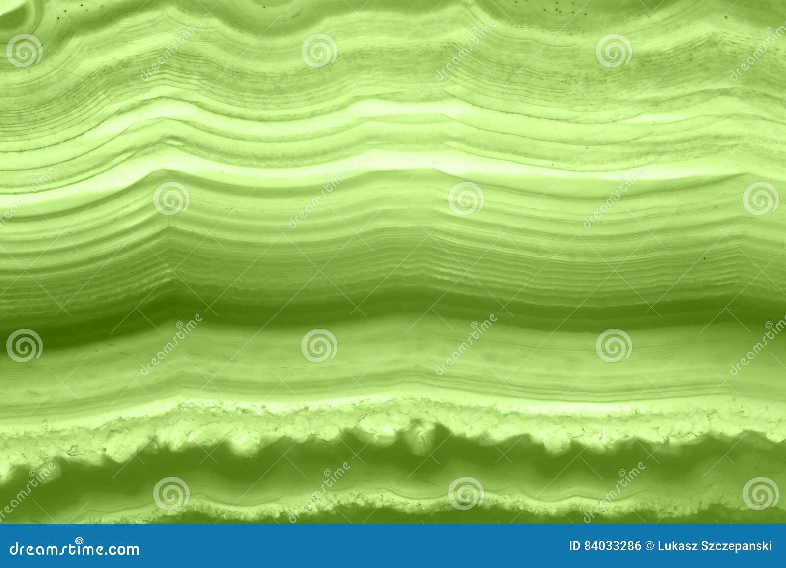 Fondo astratto - pianta minerale di macro PANTONE della fetta verde dell agata