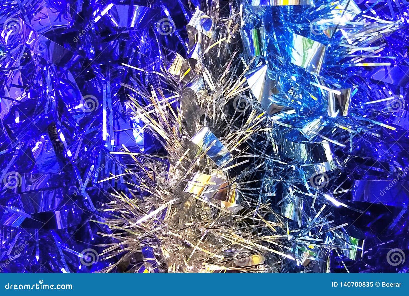 Fondo blu e d argento della decorazione del lamé del nuovo anno