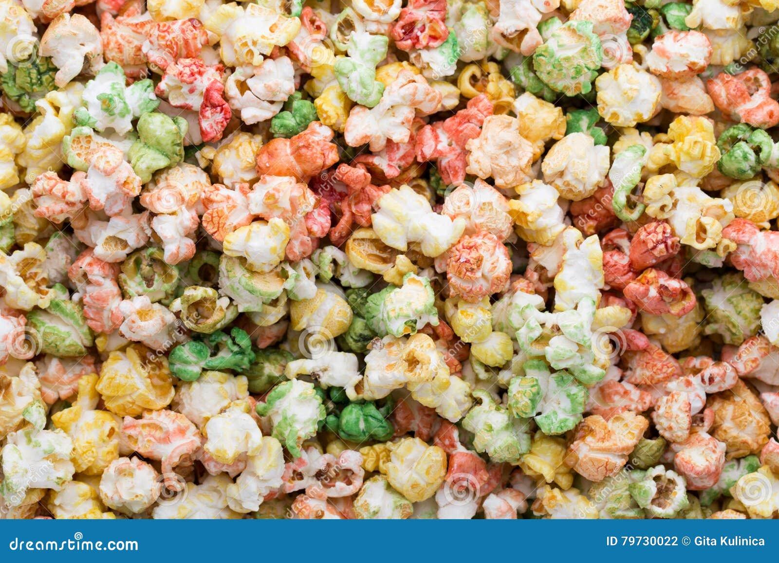 Fondo coloreado de la textura de las palomitas Palomitas dulces
