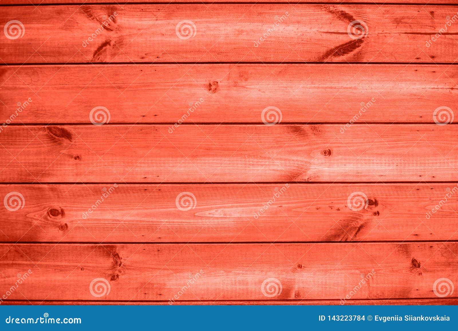 Fondo coralino de la pared del color del tablón de madera al aire libre