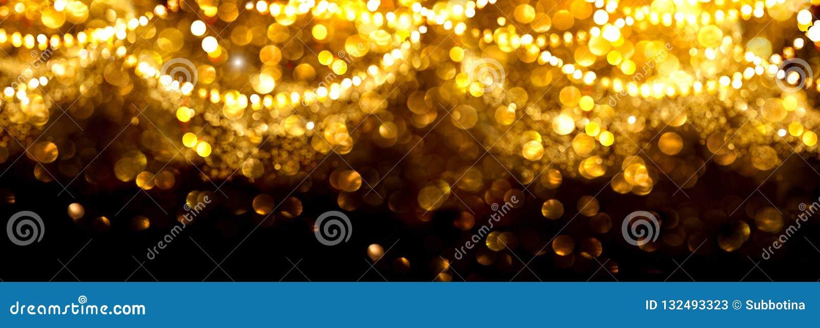 Fondo d ardore dorato di Natale Contesto defocused di scintillio dell estratto di festa dell oro con le stelle e le ghirlande di