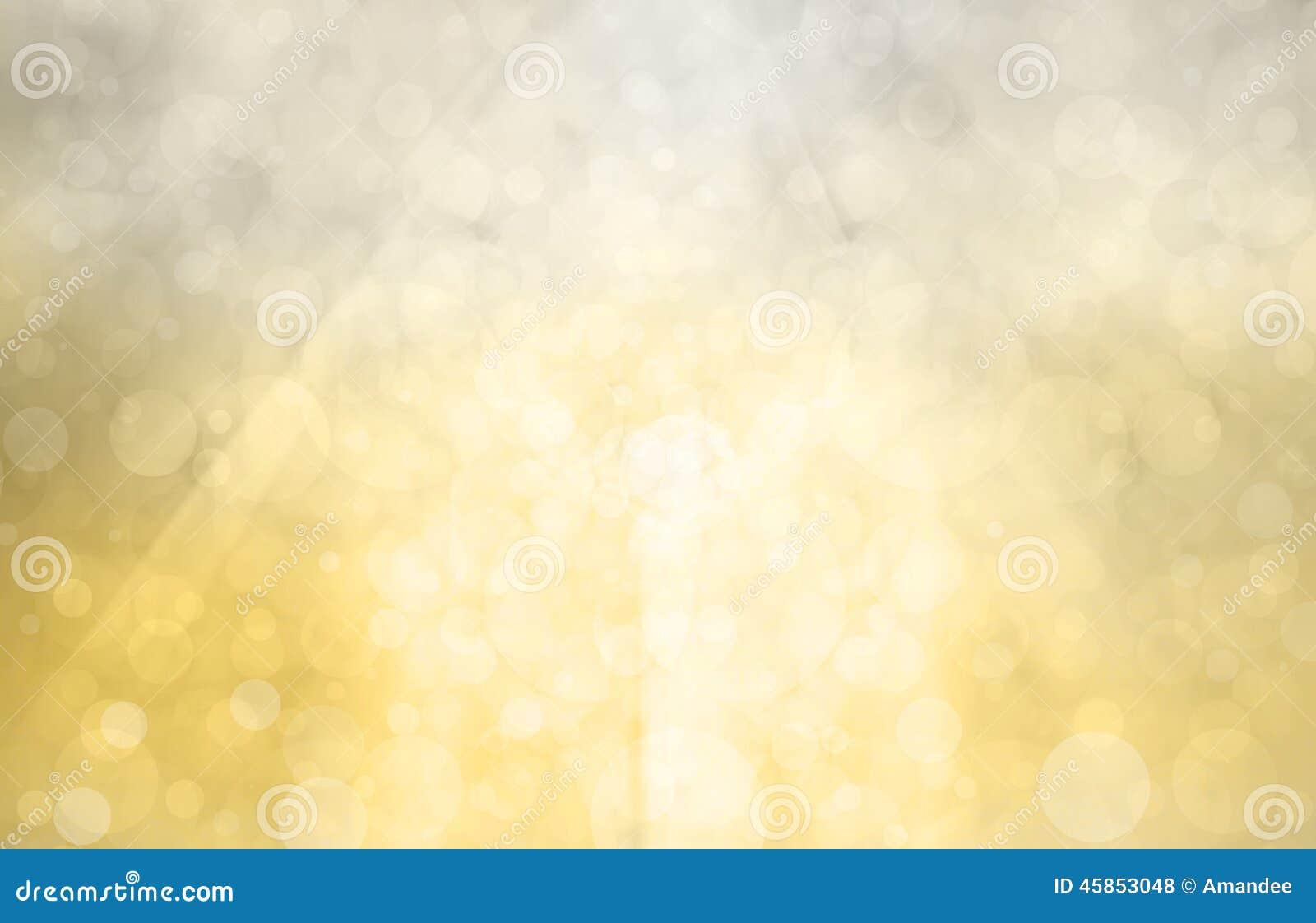 Fondo d argento dell oro con sole luminoso sui cerchi o sulle bolle del bokeh nella luce bianca luminosa