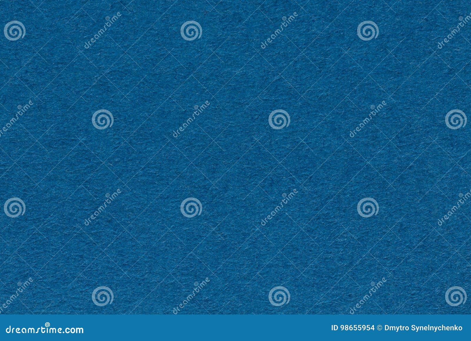 Fondo dallo strato della fine blu scuro della carta di colore su