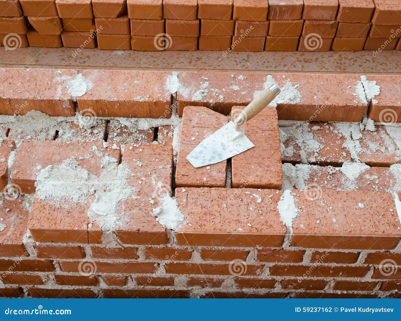 Fondo de la levantamiento de muros del albañil