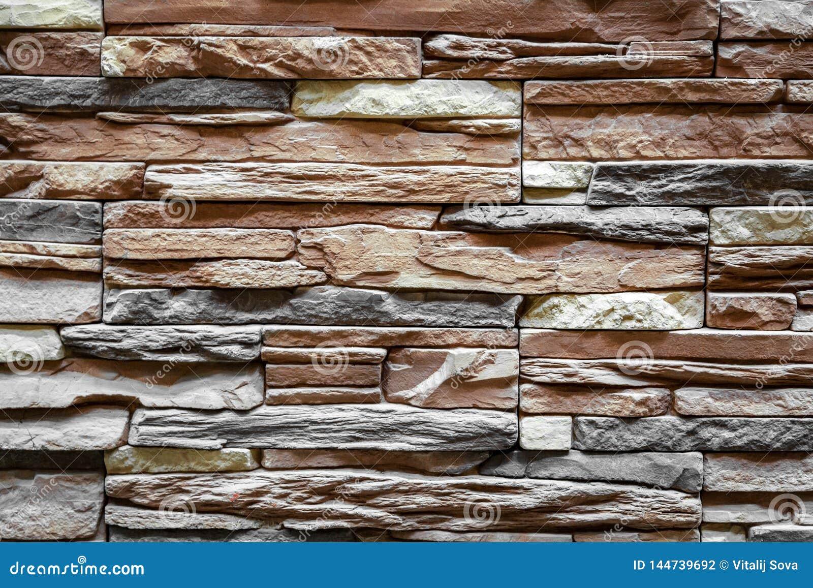 Fondo de la pared de piedra marrón hecha con los bloques
