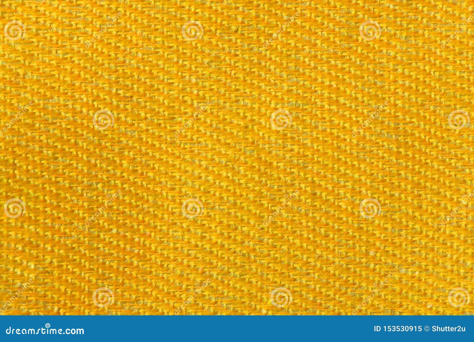 Fondo de la textura de la tela de la lona del oro amarillo Concepto de la materia textil y de la decoración Papel pintado y diseñ