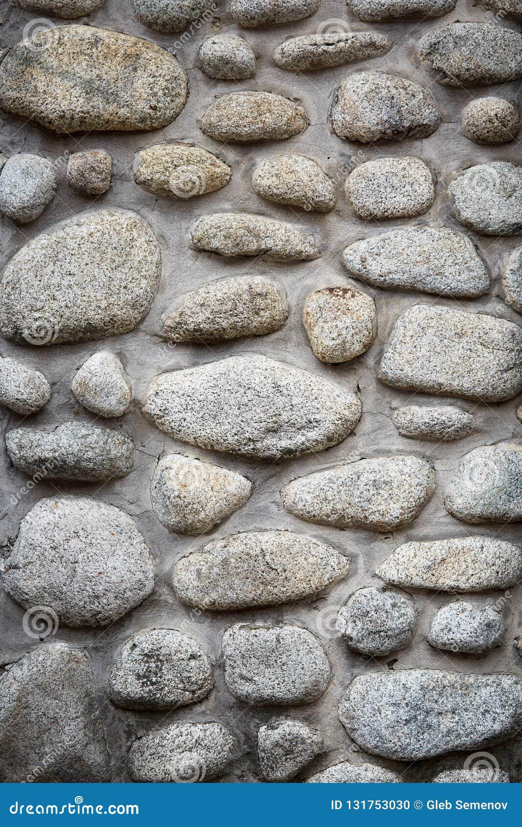 Fondo de las piedras, piedras grandes grises, cantos rodados en la albañilería, pieza de la cerca de piedra