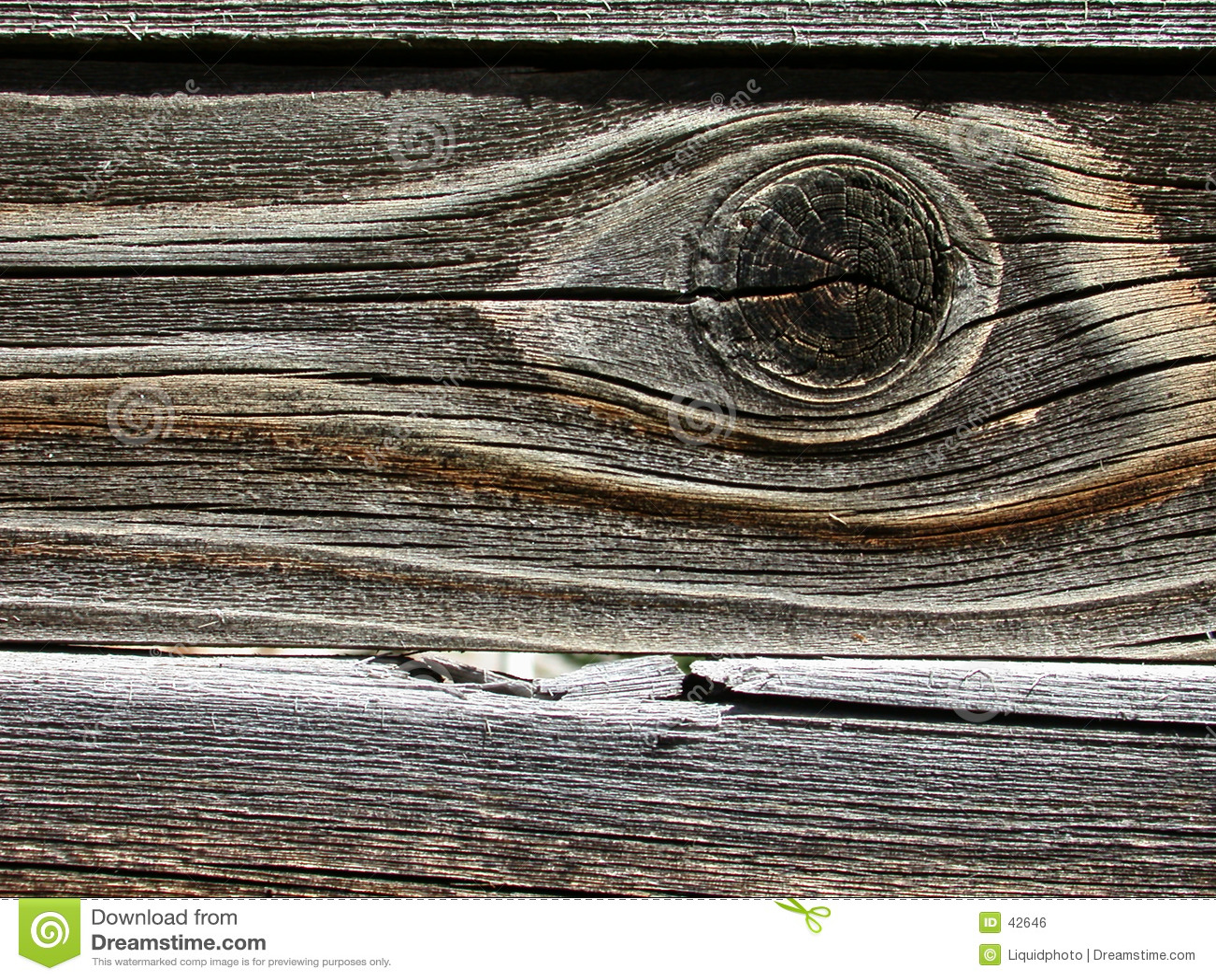 Fondo de madera del grano con el ojo