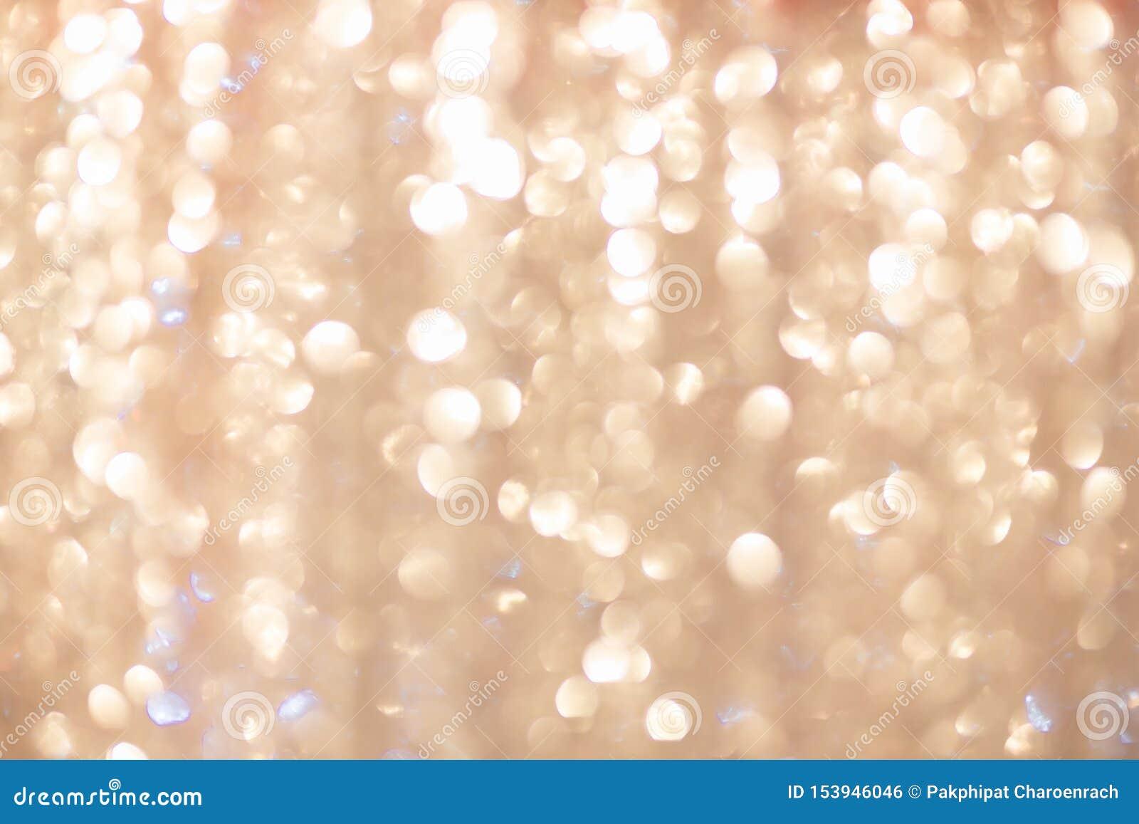 Fondo de oro que brilla intensamente de la Navidad Luces de la Navidad El extracto del Año Nuevo del día de fiesta del oro brilla
