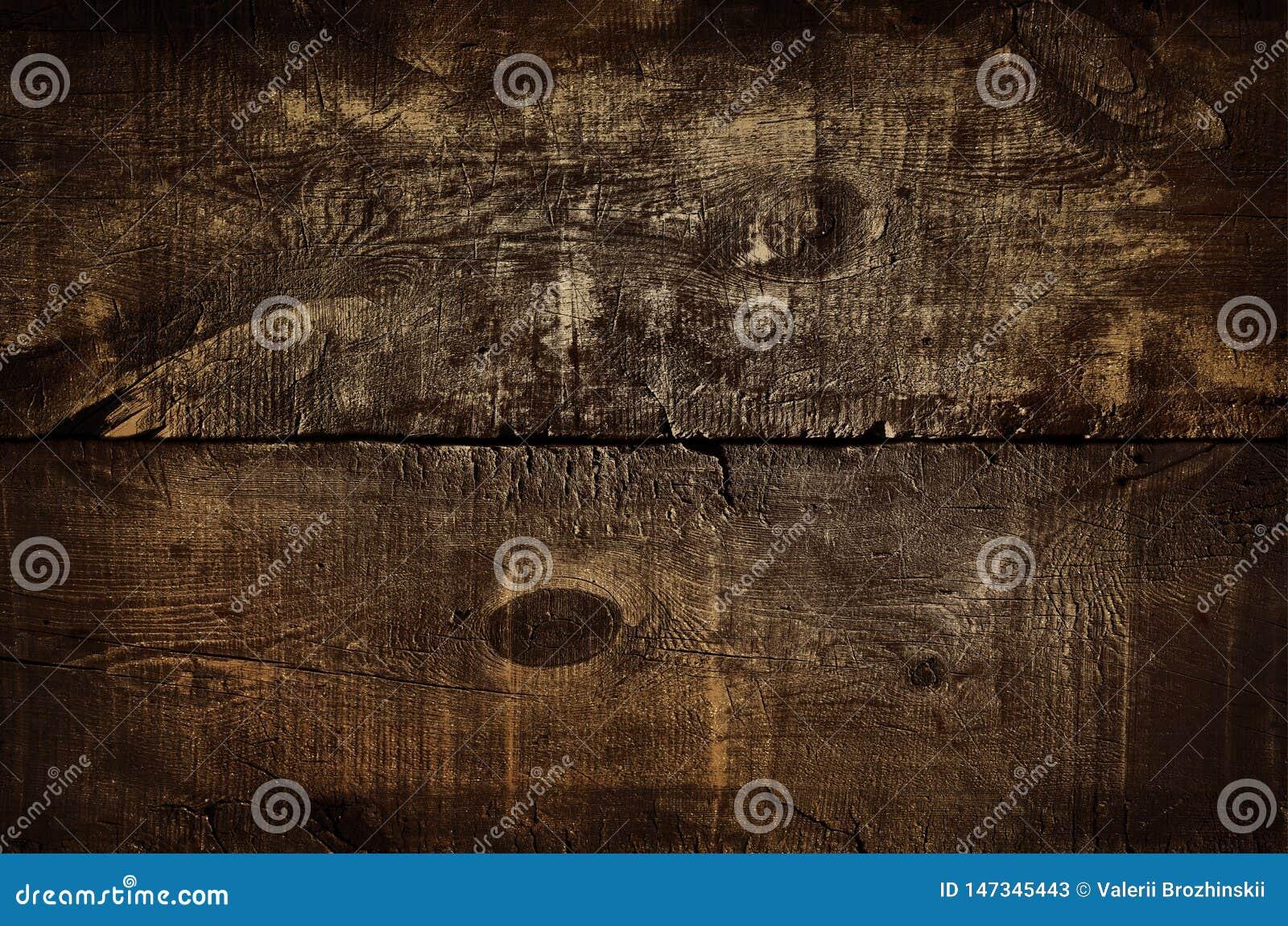 Fondo de oro rústico oscuro de la pared, textura de la tabla superior dorada vieja o