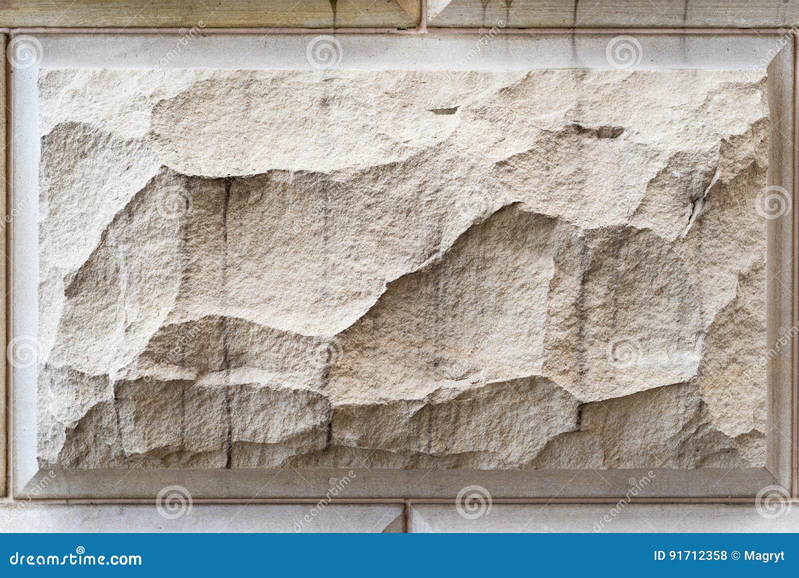 fondo de piedra textura del modelo de la pared de la arena fachada de piedra