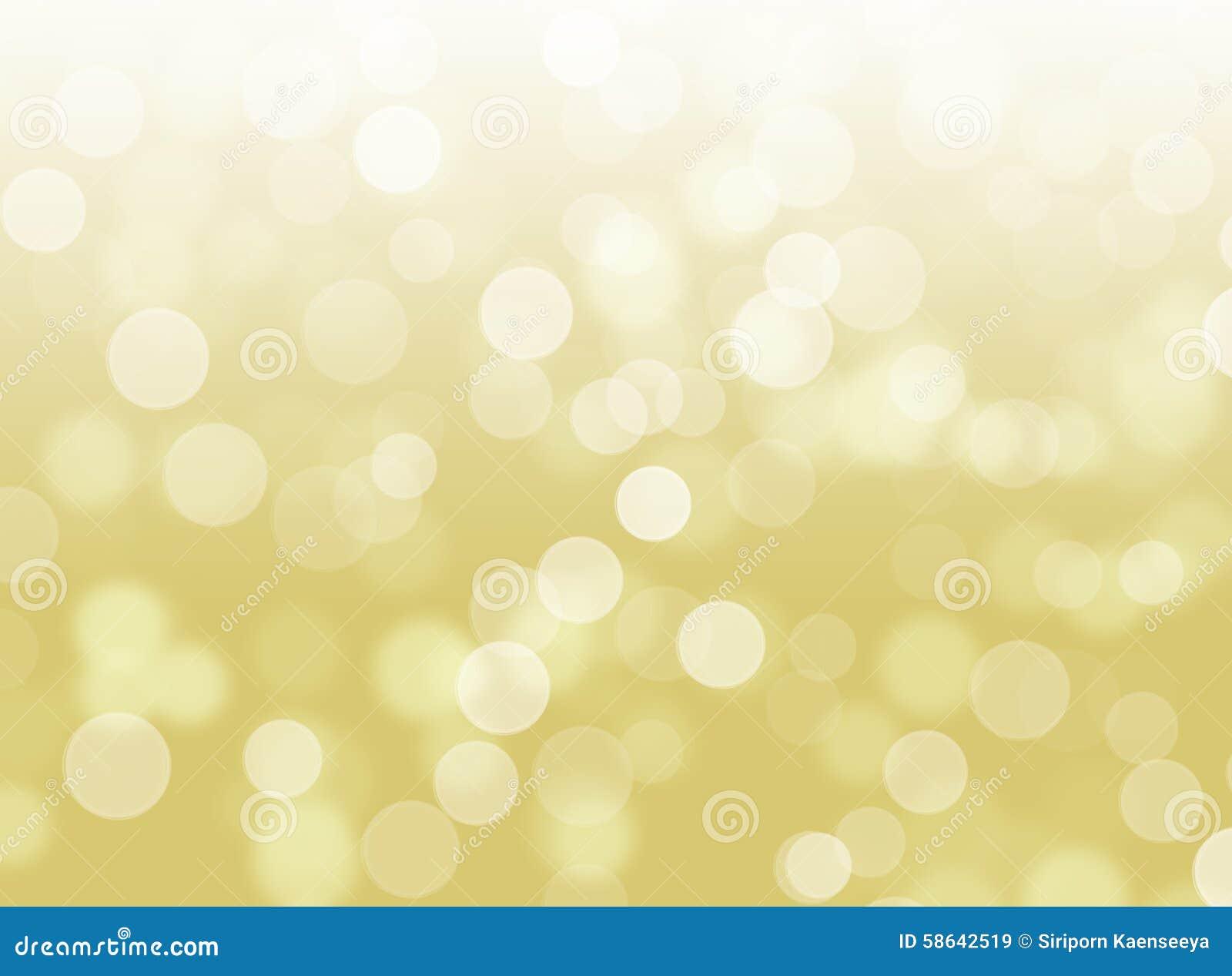 Fondo defocused del extracto del oro de Bokeh del brillo