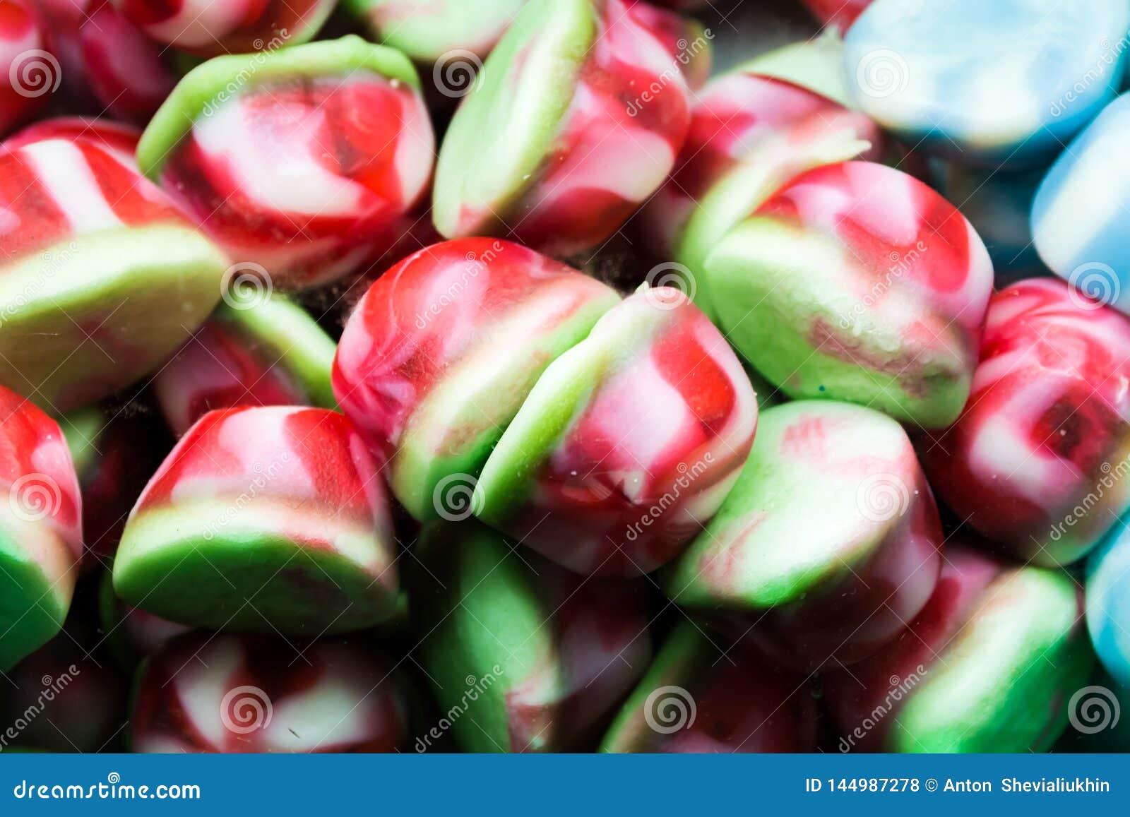 Fondo dei fagioli di gelatina assortiti colorati multi, masticante il primo piano delle caramelle