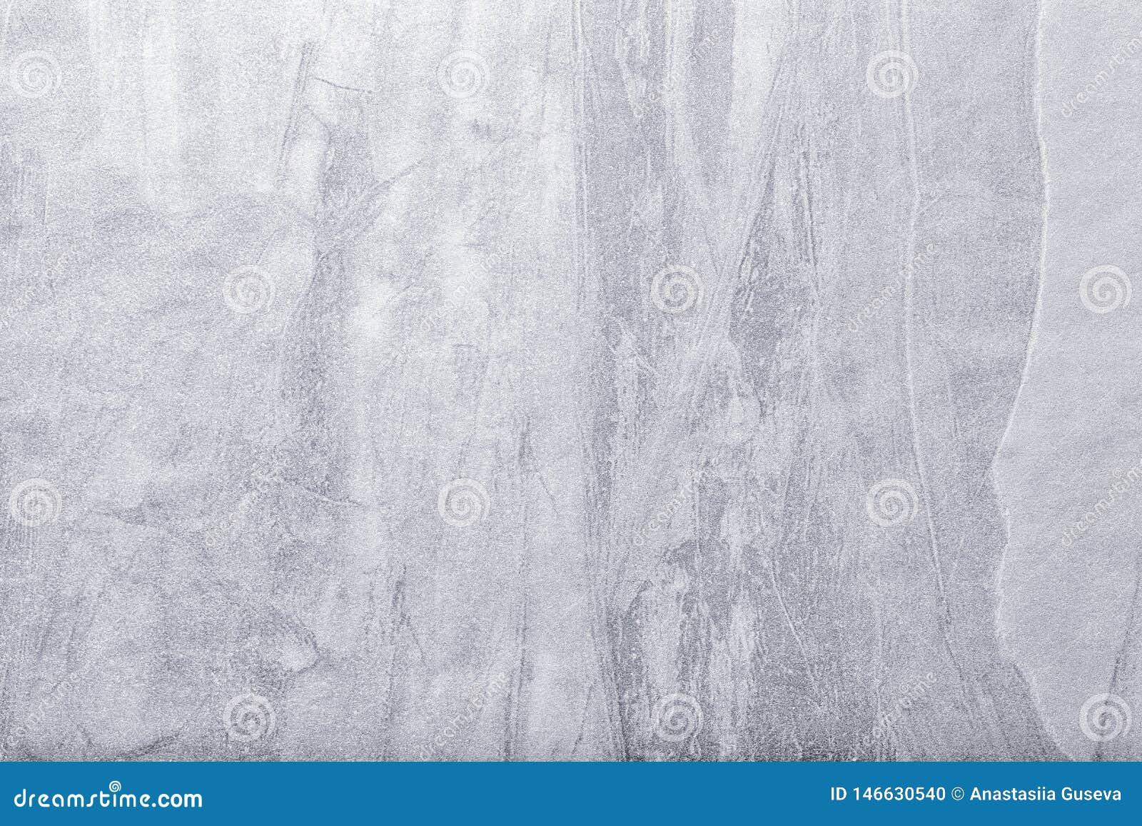 Fondo del arte abstracto gris claro y color plata Pintura multicolora en lona Contexto del estuco