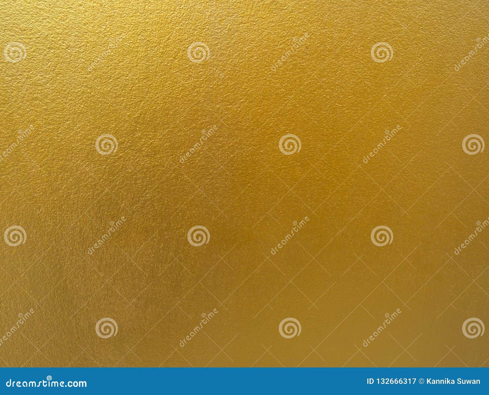 Fondo del color oro Diseño áspero de la textura del oro en la pared