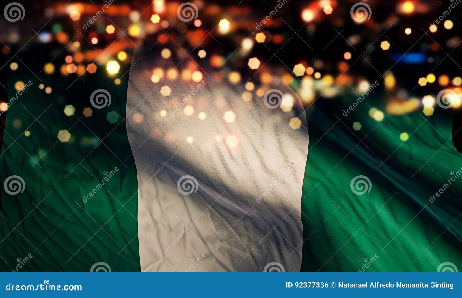 Fondo del extracto de Bokeh de la noche de la luz de la bandera nacional de Nigeria