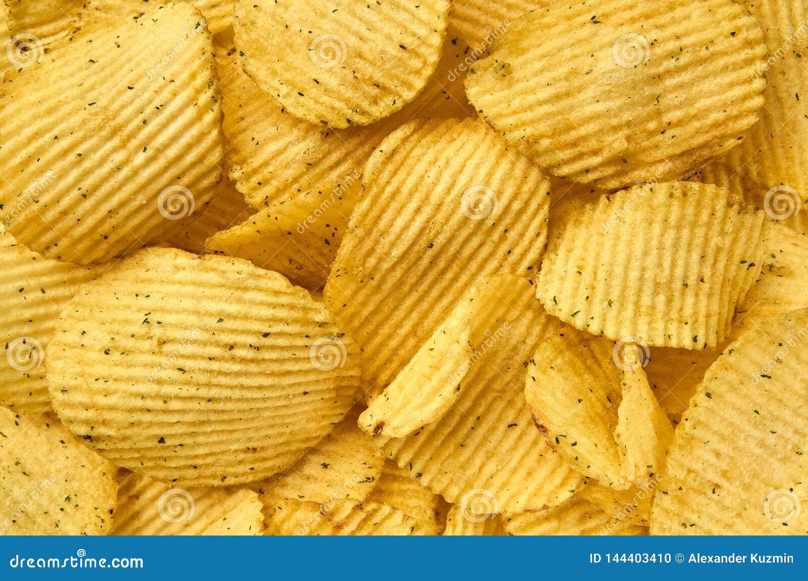 Fondo del primer acanalado jugoso de las patatas fritas