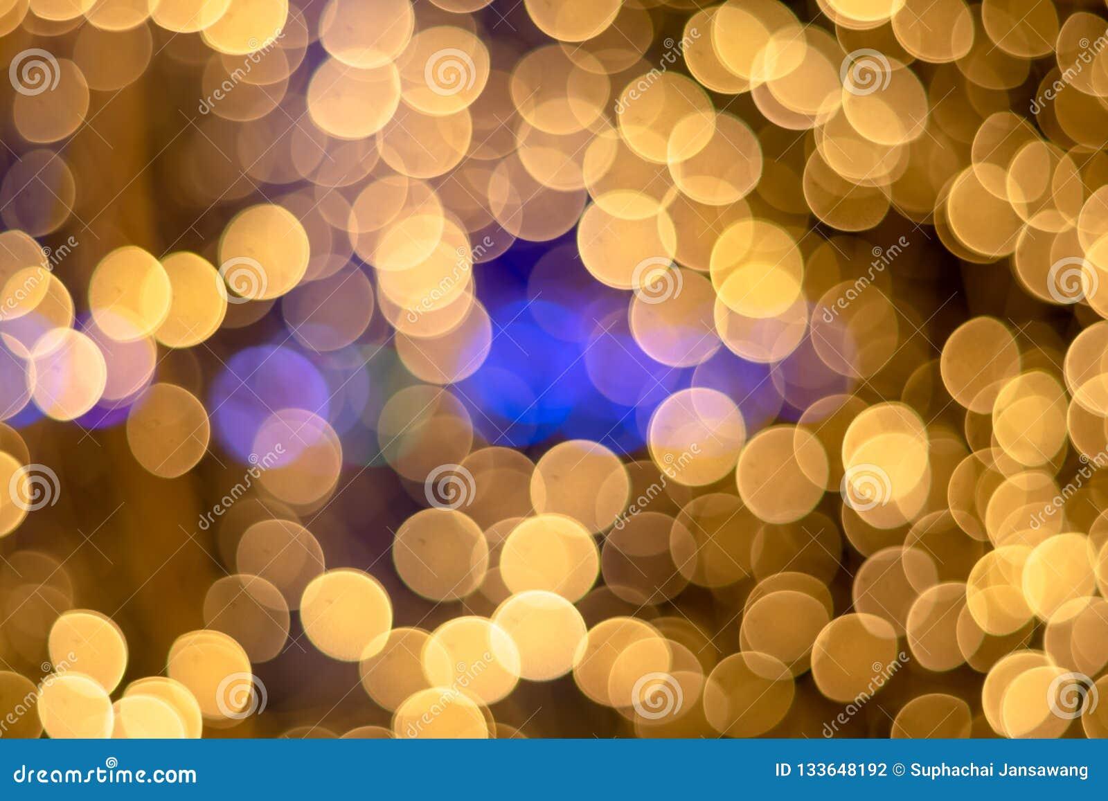 Fondo della luce dell oro di Bokeh di ฺChristmas Bello indicatore luminoso