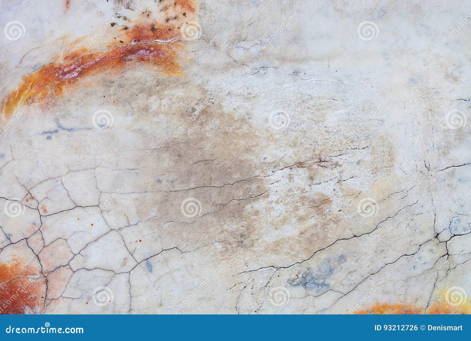 Fondo di marmo arancio di struttura delle mattonelle con le crepe
