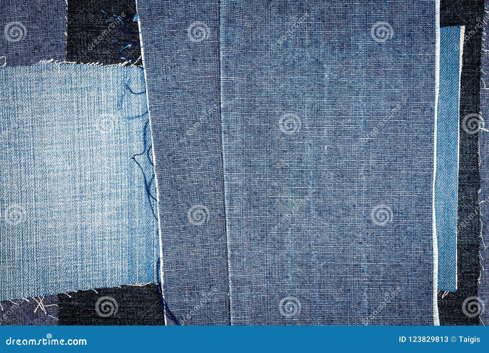 Fondo differente astratto di struttura delle bande dei jeans