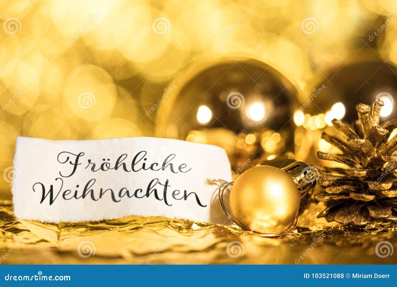 Buon Natale Que Significa.Fondo Dorato Di Natale Etichetta Con Testo Tedesco Fotografia Stock