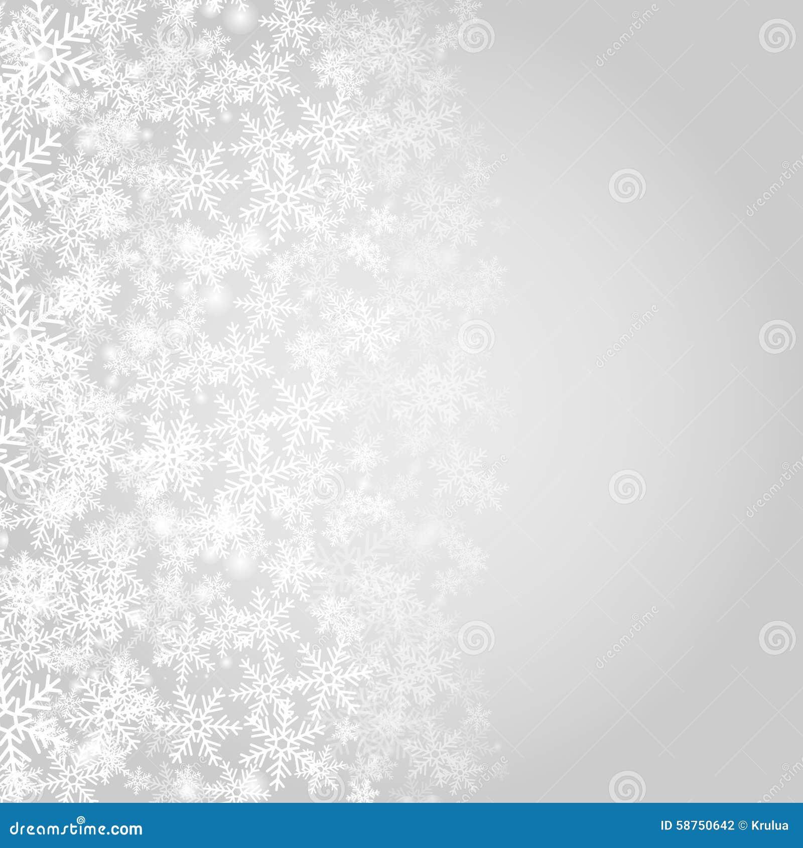 Fondo grigio astratto di Natale con i fiocchi di neve bianchi