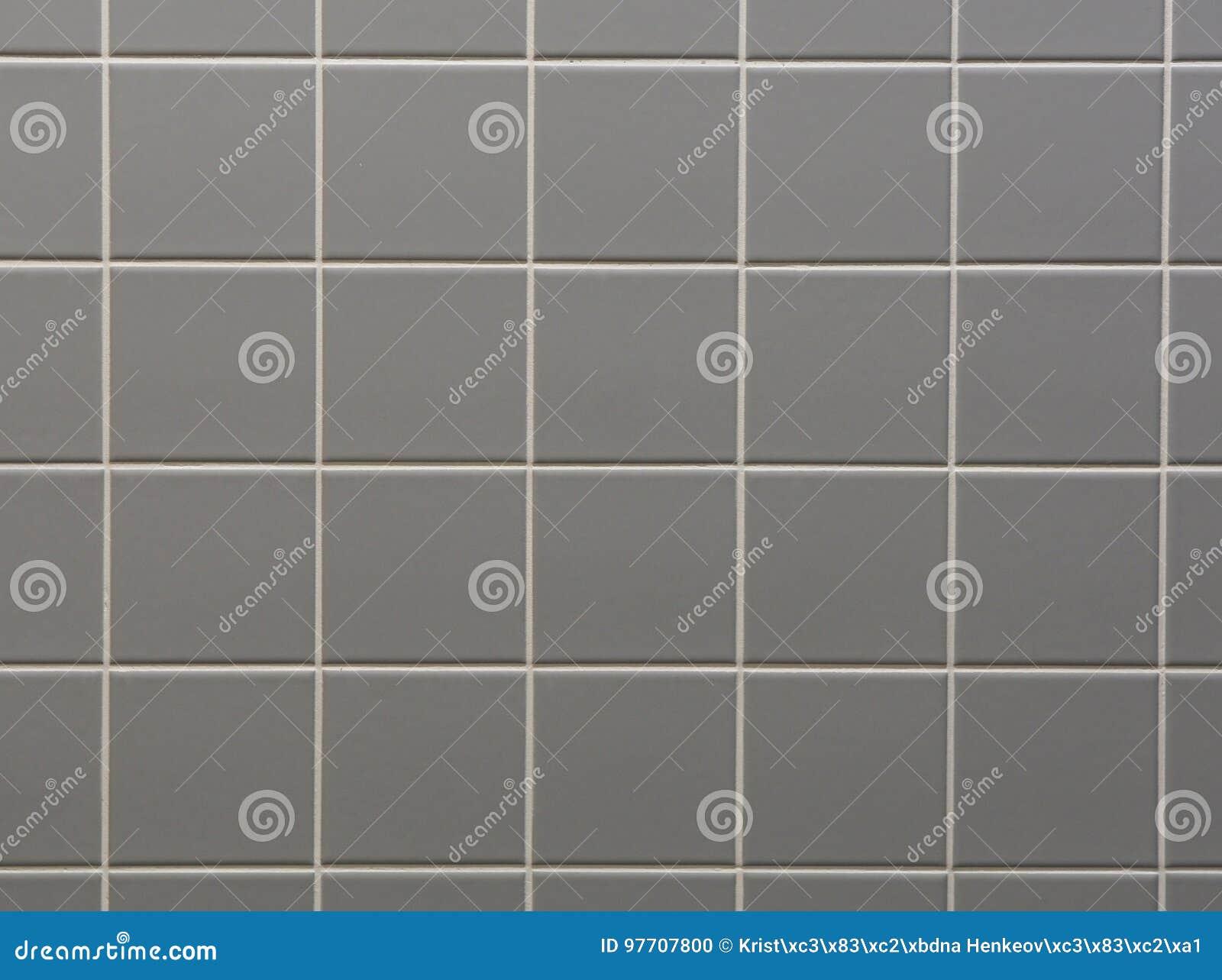 Fondo grigio delle mattonelle della parete del bagno fotografia