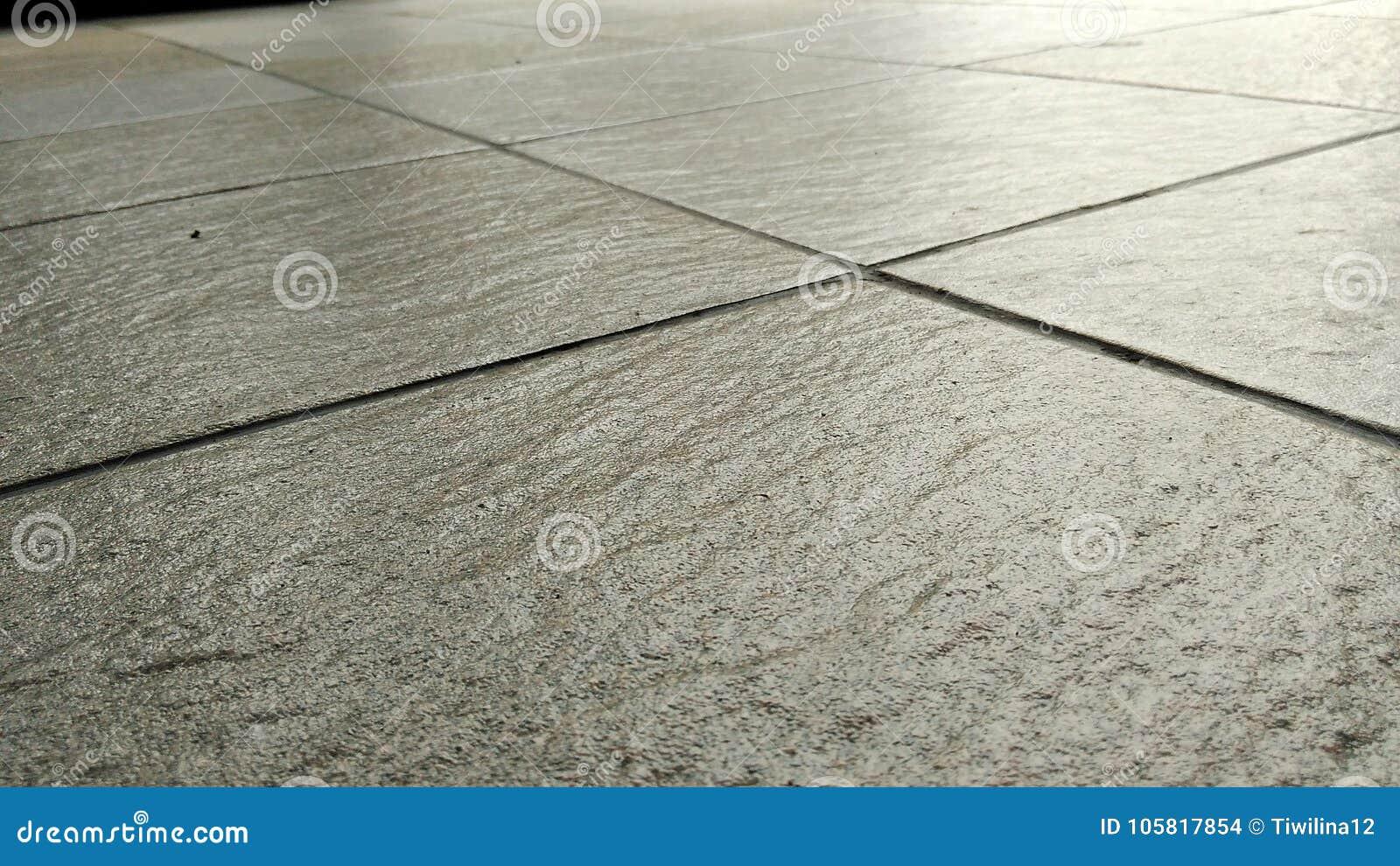 Fondo gris de los suelos de baldosas