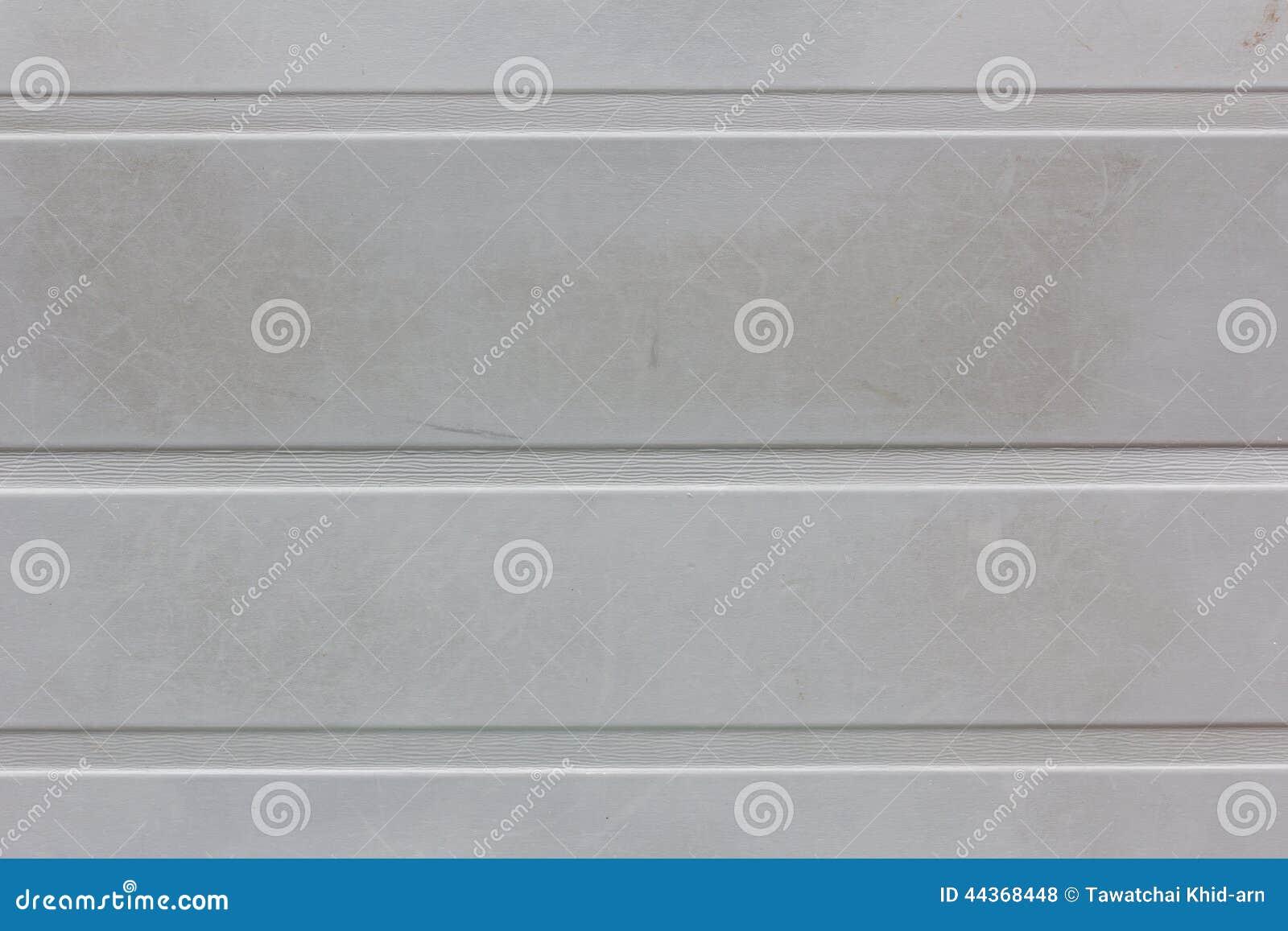 Fondo o struttura grigio sporco della parete con le strisce orizzontali