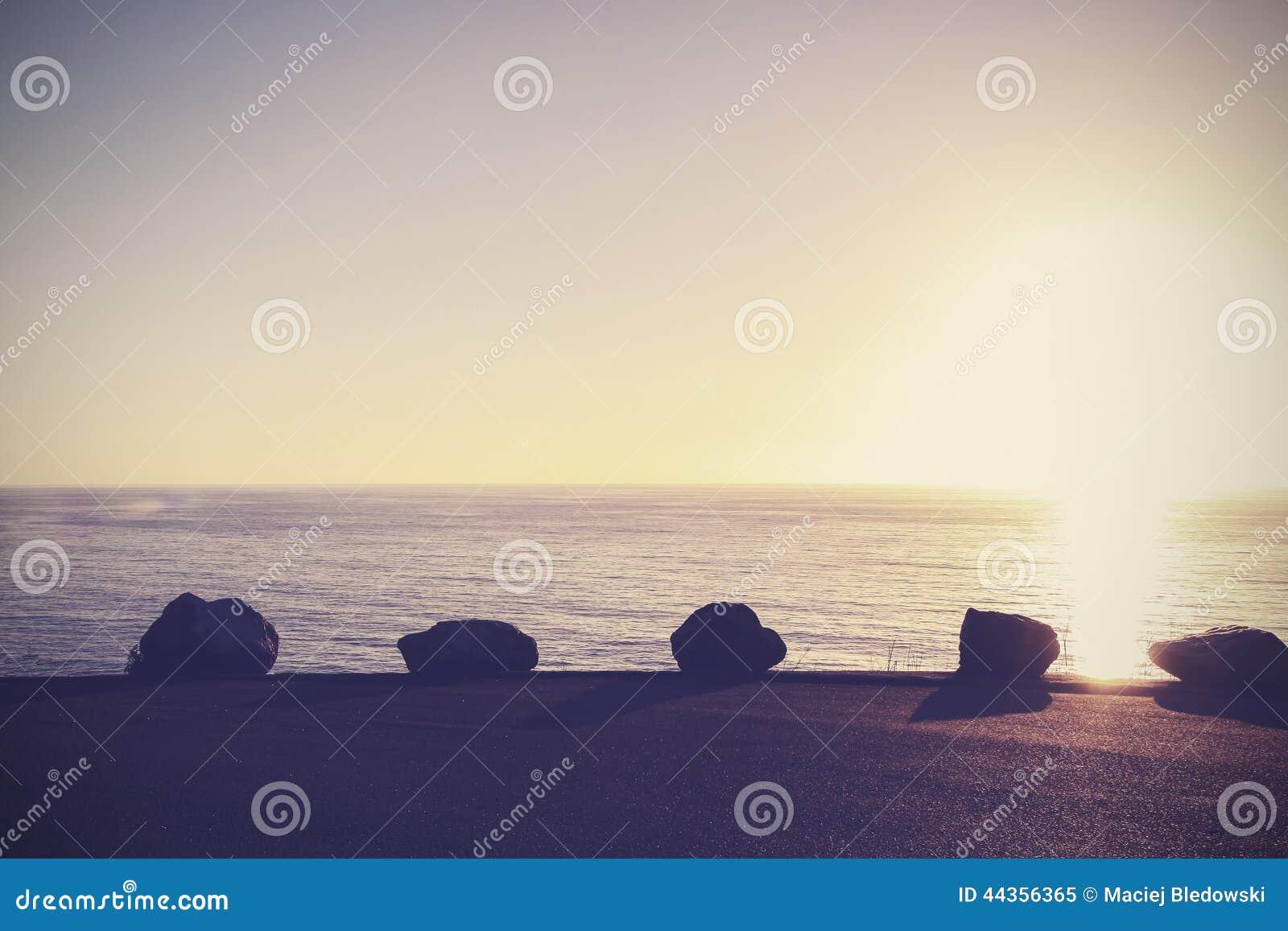 Fondo pacifico d annata della natura, tramonto sopra l oceano
