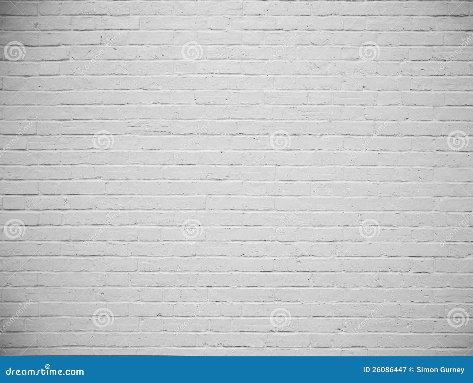 Fondo pintado blanco en blanco de la pared de ladrillo