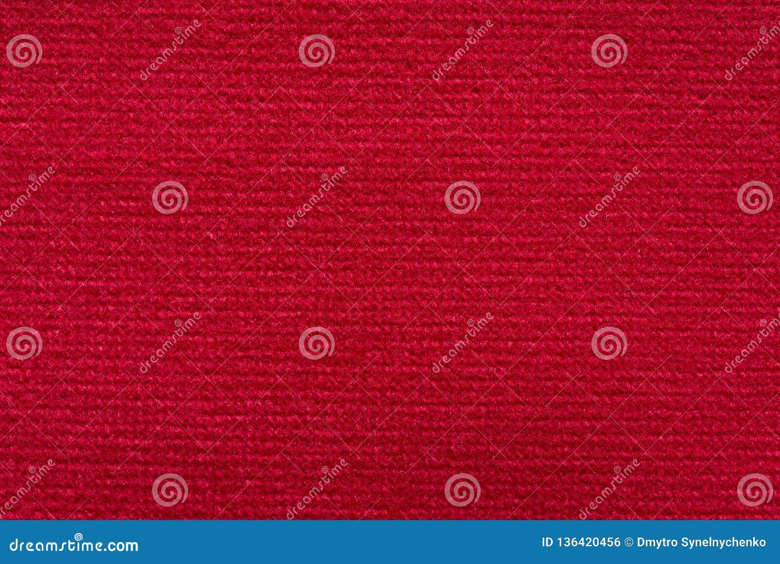 Fondo rojo de la materia textil del contraste fantástico en macro