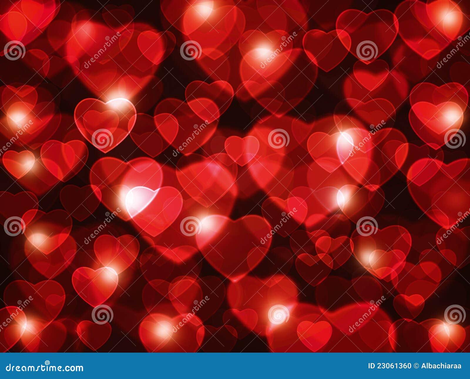fondo rojo hermoso de la lente de los corazones stock de