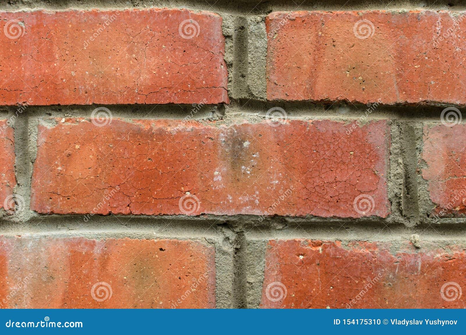 Fondo rosso del muro di mattoni con i dettagli