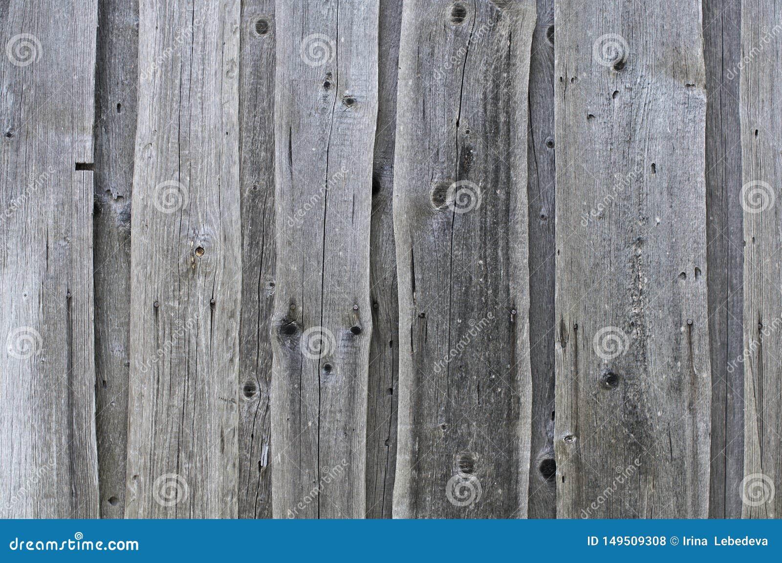 Fondo strutturato dei bordi sbiaditi grigi anziani coperti di crepe